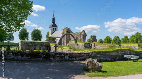 Gudhem Historical Monastery Ruin and Church in rural environment with overgrown stone walls and arches during Summer near Falkoping Vastra Gotaland, Sweden.
