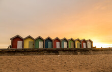 The Vibrant And Colorful Beach Huts By The Promenade Overlooking Blyth Beach With A Lovely Sunset In Northumberland, England