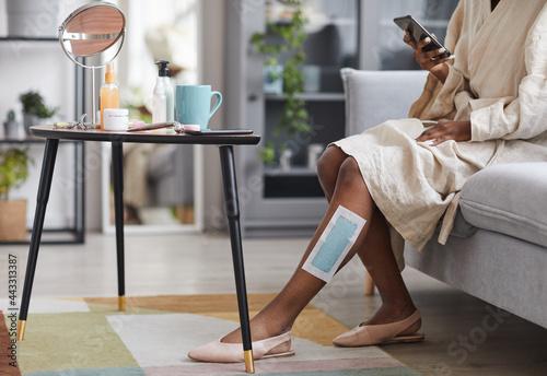 Fototapeta Portrait of unrecognizable African-American woman enjoying beauty routine at hom