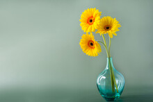 Bouquet Of Yellow Daisy-gerbera Flowers In A Stylish Glass Vase On Muted Green Background. Floral Background With Copy Space.