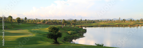 Golf course, lake, sky and green grass,Tropical golf course at sunset, Thailand