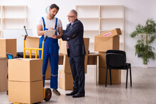 Old Businessman And Young Contractor In Relocation Concept