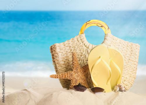 Different beach objects on sandy beach near sea