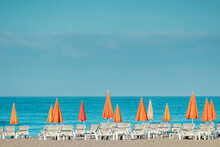 Morning Sea, Beach, Empty Sun Beds For Vacationers. Vacation Concept.