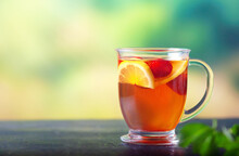 Fresh Tea With Lemon And Strawberries In A Large Glass Cup