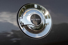 """Inscription """"fuel"""" On Lid Of Gas Tank Of Car With An Internal Combustion Engine."""
