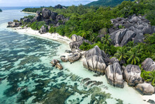"""""""La Digue"""" Island In Seychelles. Silver Beach With Granitic Stone, And Jungle. Aerial View Shot With Mavic2"""