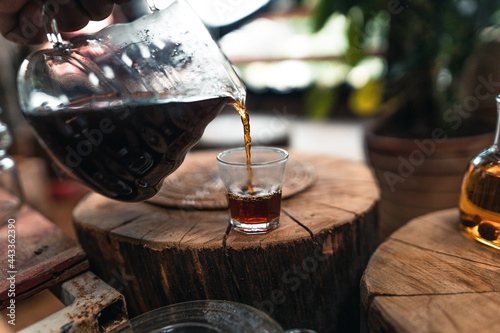Obraz na plátně Pouring a hot water over a drip coffee