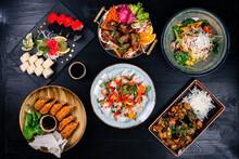 Asian Food Cooking. Wok, Noodles And Vegetables Salad And Chopsticks On Dark Rustic Background