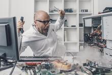 Burning Computer On The Technician Desk