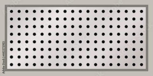 Fototapeta Rectangular peg board perforated with round holes