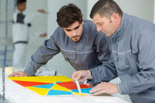 Obraz na plátně professional interior renovation crew at work in house