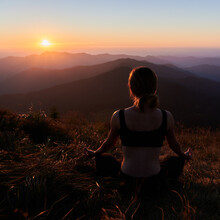 Back View Of Young Woman In Special Sportswear Doing Meditation On Fresh Air. Concept Of Freedom With Nature.