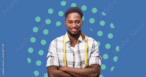 Composition of male fashion designer smiling on blue background