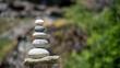 Runde Steine aufgetürmt- Symbolbild Balance - Work Life Balance