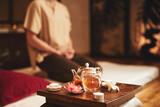 Man doing meditation during tea ceremony indoors