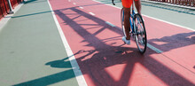 Bicycle Red Road On The Pedestrian Bridge. Close-up Photo.