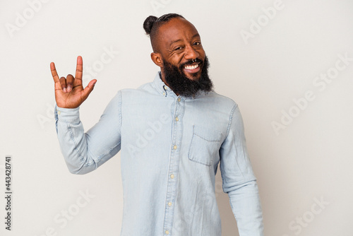 Canvas African american man with beard isolated on pink background showing a horns gesture as a revolution concept