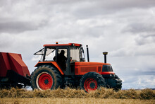 Tractor And Haystack On Field