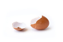 Cracked Or Broken Brown Egg Shell Isolated On White Background. Breakfast Food
