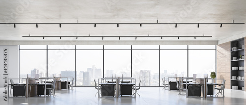 Wide coworking office interior with concrete floor, windows with panoramic city view and workplace furniture. Corporate workspace concept. 3D Rendering.