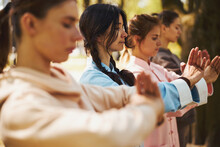 Tai Chi Greeting Performed By Women On Outdoor Training