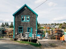 A House With Stacks Of Lobster Cages, In Port Clyde, Saint George, Maine
