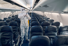Man Doing The Antiviral Disinfection Aboard The Plane