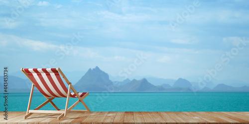 Obraz na plátne Beach Chair on wooden deck terrace on the beach with beautiful seascape