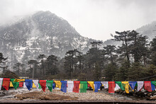 Snow Cap Mountains With Buddhist Prayer Flags At Morning