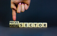 Private Or Public Sector Symbol. Businessman Turns Cubes And Changes Words 'public Sector' To 'private Sector'. Beautiful Grey Background, Copy Space. Business, Private Or Public Sector Concept.