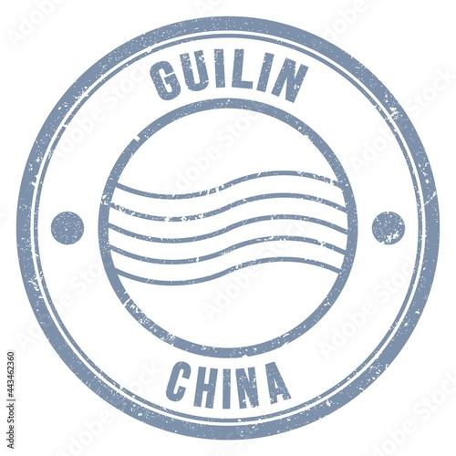 Fototapeta GUILIN - CHINA, words written on gray postal stamp