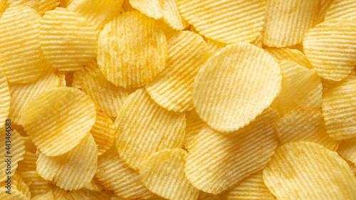 Cuadros en Lienzo crispy golden potato chips snack texture background