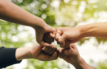 4 People Join Forces, The Concept Of Hand-to-hand To Create Unity, Group Of People, Hands, Teamwork Business Group By Reaching Out In A Circle The Power Of Work Is Friendship With Business Colleagues.