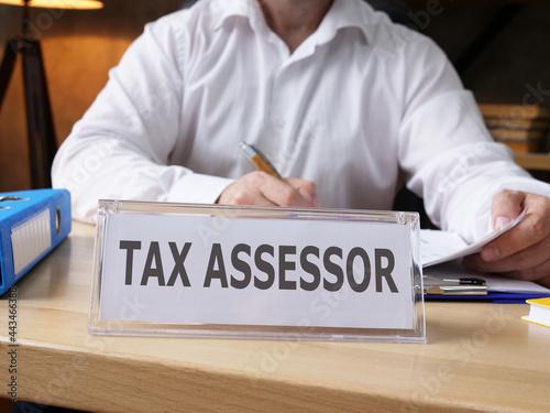 Obraz na płótnie Tax assessor is shown on the business photo using the text