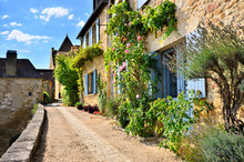 Beautiful Street In France Filled With Vines And Flowers In The Dordogne Village Of Beynac