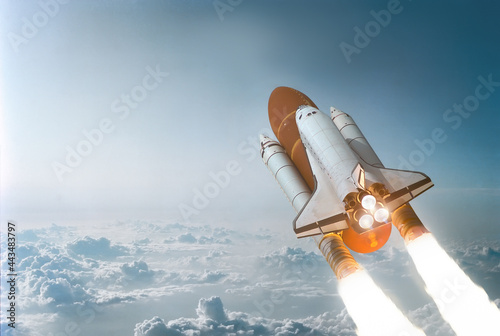 Fotografiet Space shuttle in the blue sky with cloud