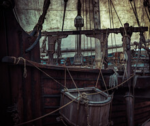 Old Pirate Ship With Sail Mast And Ropes As Gloomy Vintage Retro Background