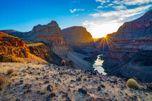 The Sun Rises Over The Colorado River And The Grand Canyon