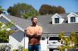 Man real estate, rental house. Portrait of confident man standing outside new home. Successful real estate agent purchasing house for investment purpose.