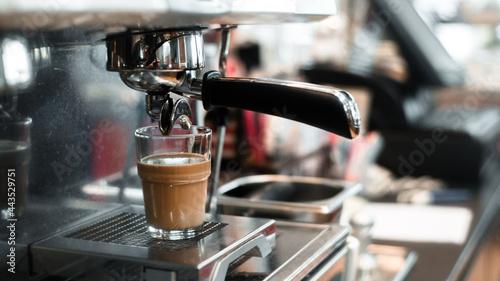 Fotografie, Obraz black coffee with milk on coffee maker