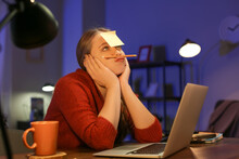Female Freelancer Working At Home Late In Evening