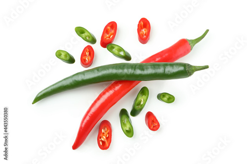Fotografiet Green and red hot chili peppers and slices isolated on white background