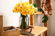 Leinwandbild Motiv Bouquet of beautiful narcissus flowers on table in room