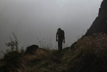 Man With Backpack Hiking In Fog