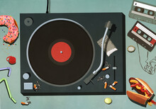 Junk Food, Cigarettes And Cassette Tapes Around Record Turntable