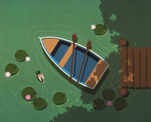 Rowboat And Paddles On Tranquil Lake With Lily Pads