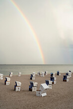 Rainbow Over Cabanas On Tranquil Ocean Beach, Schleswig-Holstein, Germany