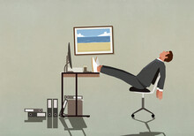 Tired Businessman Sleeping With Feet Up On Desk