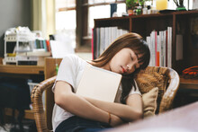 Asian Teenager Student Woman Hold Digital Tablet And Take A Sitting Nap On Chair Stay At Home.